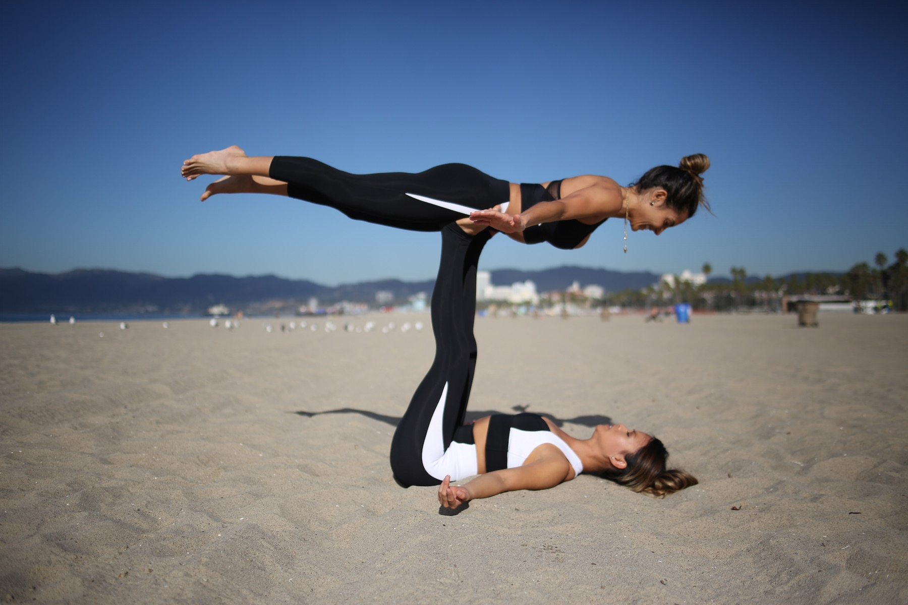 3 Partner Yoga Poses To Try With Your Friends Family