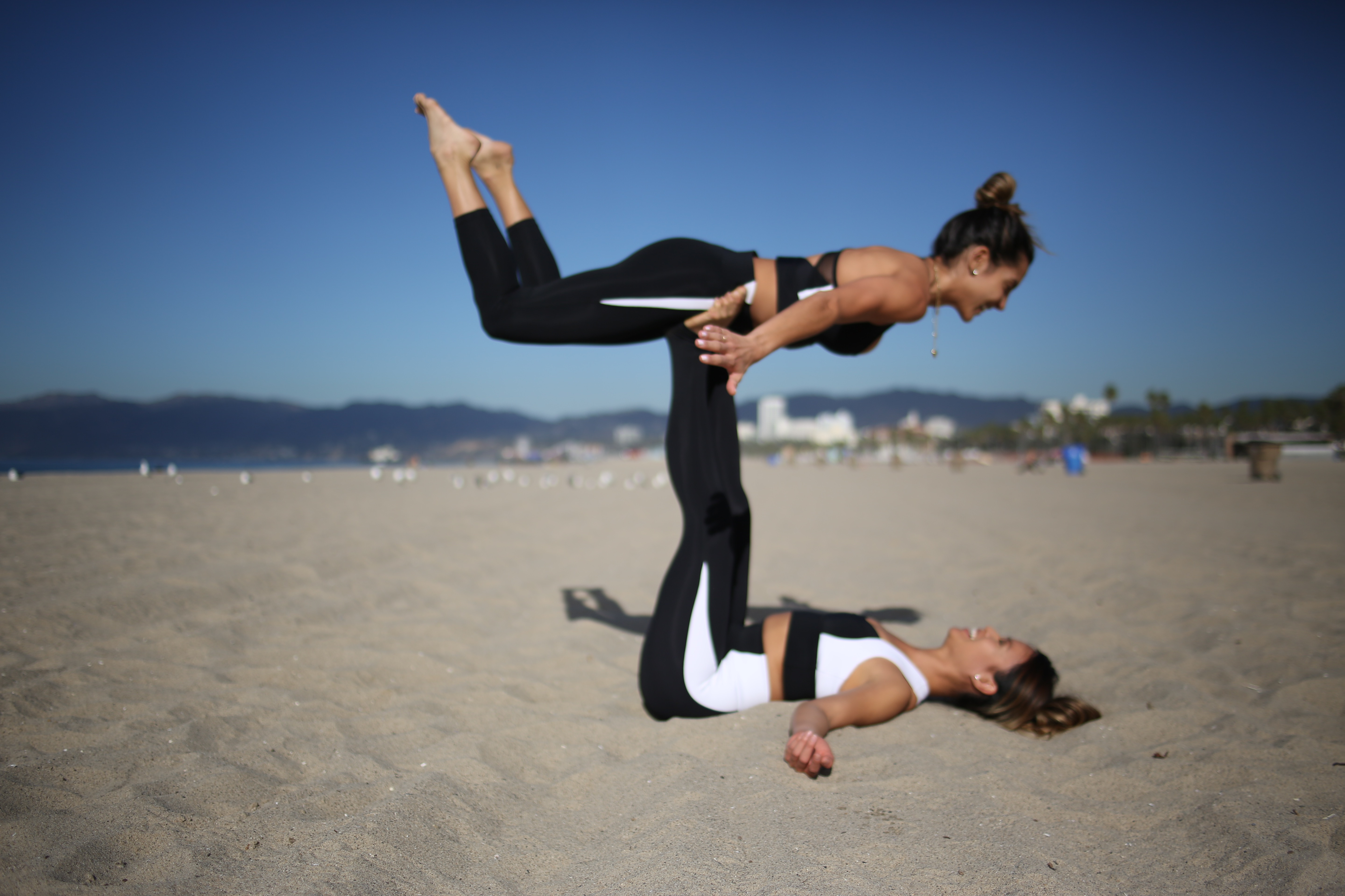 3 Partner Yoga Poses To Try With Your Friends Or Family